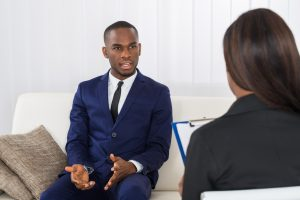 Young Man Explaining His Problems To The Psychologist